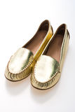 Beautiful luxury fashion golden woman shoes Stock Images