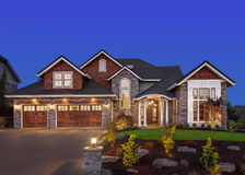 Beautiful Luxury Home Exterior in Evening, with Deep Blue Sky Stock Images