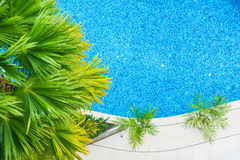 Beautiful luxury hotel swimming pool resort. Aerial view of Beautiful luxury hotel swimming pool resort with umbrella and chair - Boost up color processing Royalty Free Stock Photo