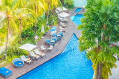 Beautiful luxury hotel swimming pool resort. Aerial view of Beautiful luxury hotel swimming pool resort with umbrella and chair - Boost up color processing Stock Photos