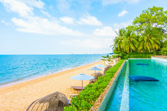 Beautiful luxury hotel swimming pool resort. With beach and sea - Boost up color Processing Stock Images