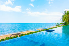 Beautiful luxury hotel swimming pool resort. With beach and sea - Boost up color Processing Royalty Free Stock Image