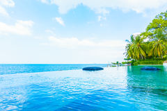 Beautiful luxury hotel swimming pool resort. With beach and sea - Boost up color Processing Stock Photos