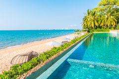 Beautiful luxury hotel swimming pool resort. With beach and sea - Boost up color Processing Royalty Free Stock Photo