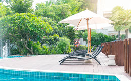 Beautiful luxury hotel swimming pool resort with umbrella and ch. Air - with sunflare effect Stock Photo