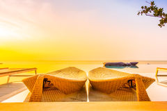 Beautiful luxury hotel swimming pool resort. With umbrella and chair on the beach and sea - Vintage Filter and Boost up color Processing Stock Image