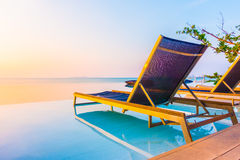 Beautiful luxury hotel swimming pool resort. With umbrella and chair on the beach and sea - Vintage Filter and Boost up color Processing Royalty Free Stock Photos