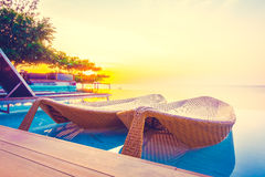 Beautiful luxury hotel swimming pool resort. With umbrella and chair on the beach and sea - Vintage Filter and Boost up color Processing Royalty Free Stock Photography