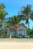 Houses in tropical resort. Beautiful luxury houses in tropical resort on the beach Stock Images
