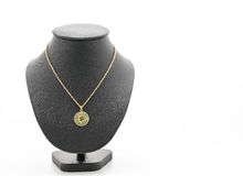 Beautiful and luxury necklace with jewelry stand neck. On white background royalty free stock image