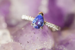 Beautiful luxury ring on Ametyst. Closeup of a Ring of Sapphire and Ruby Stock Photos