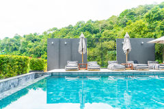 Beautiful luxury swimming pool in hotel pool resort Stock Images