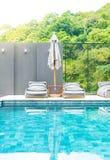 Beautiful luxury swimming pool in hotel pool resort Stock Photography