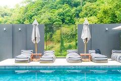 Beautiful luxury swimming pool in hotel pool resort Stock Photos