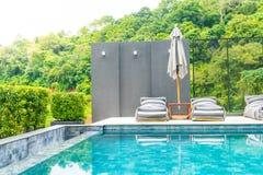 Beautiful luxury swimming pool in hotel pool resort Royalty Free Stock Photography