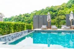 Beautiful luxury swimming pool in hotel pool resort Stock Photo