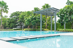 Beautiful luxury swimming pool with palm tree Royalty Free Stock Photo