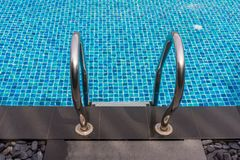 Beautiful luxury swimming pool with Pool stair on sunny day stock photo