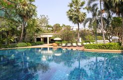 Beautiful luxury swimming pool in tropical hotel pool resort royalty free stock photography