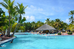 Beautiful luxury swimming pool at a tropical resort, People relax at the hotel. Stock Photos