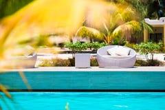 Beautiful luxury umbrella beach and chair around swimming in hotel resort Stock Image