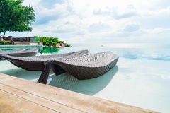 Beautiful luxury umbrella and chair around outdoor swimming pool Royalty Free Stock Photo