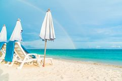 Beautiful luxury umbrella and chair on beach Stock Photos