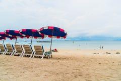 Beautiful luxury umbrella and chair on beach Stock Image