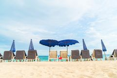 Beautiful luxury umbrella and chair on beach Royalty Free Stock Images