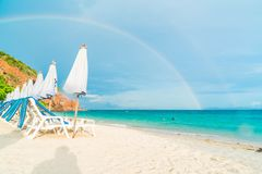 Beautiful luxury umbrella and chair on beach Royalty Free Stock Image