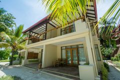 Beautiful luxury villa located at the tropical resort Stock Photos