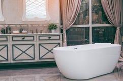 Beautiful luxury vintage empty bathtub Freestanding white bath. Bathroom is beautifully royalty free stock photography