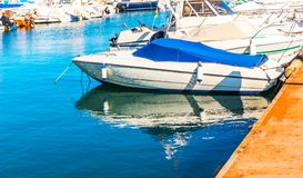 Beautiful luxury yachts and motor boats anchored in the harbor,. Hot summer day and blue water in the marina, blue sky, vacation Stock Images