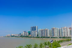 Beautiful Macao city in the horizont with some modern buildings in a beautiful blue sky.  Royalty Free Stock Photos