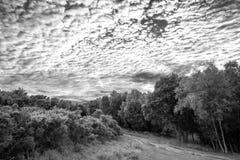 Beautiful mackerel sky cirrocumulus altocumulus cloud formations. Stunning mackerel sky cirrocumulus altocumulus cloud formations in Summer sky landscape black Stock Photography