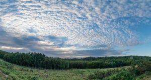 Beautiful mackerel sky cirrocumulus altocumulus cloud formations. Stunning mackerel sky cirrocumulus altocumulus cloud formations in Summer sky landscape Royalty Free Stock Image