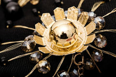 Beautiful macro golden flower with crystal beads Royalty Free Stock Photography