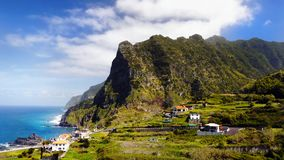 Beautiful Madeira Island. Mountains and blue Atlantic Ocean, landscape panorama. Portugal. Coastline, cliffs Stock Photos