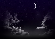Beautiful magic blue sky with clouds and moon and stars at night closeupr Stock Photos