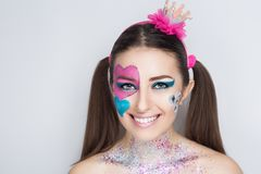 Hearts make up. Beautiful magical charming woman, love princess with big and small painted hearts on face. hair tails. Figure paint her cheek blush, bright Stock Photos