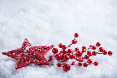 Beautiful magical vintage red star on a white snow background. Winter and Christmas concept. Stock Photography