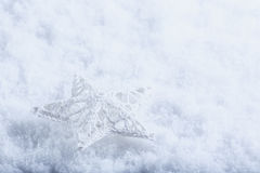 Beautiful magical vintage white star on a white snow background. Winter and Christmas concept. Royalty Free Stock Photo