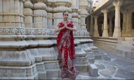 Beautiful Maharani. Young indian woman in traditional clothing w. Beautiful Maharani. Namaste. Indian Woman in Red Bridal Sari clothing with bridal oriental Stock Images