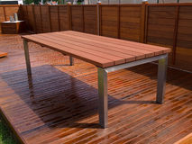 Beautiful mahogany hardwood deck floor and table. Beautiful design outdoors deck mahogany hardwood floor and table Stock Photo