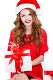 Beautiful maiden with a gift on a white background. Stock Image