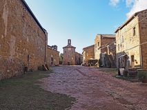The beautiful main square of Sovana, Italy. A morning view of the main square in the medieval city of Sovana in Tuscany, Italy stock photos