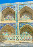 The beautiful majolica. The arches of Nadir Divan-Beghi madrasah is decorated with multicolored majolica with floral and geometric traceries, Bukhara, Uzbekistan Royalty Free Stock Photo