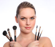Beautiful make up artist with cosmetic brushes Stock Photos