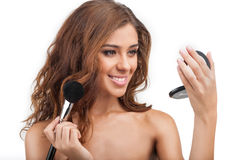 Beautiful make-up. Portrait of beautiful young women doing make- Royalty Free Stock Photos