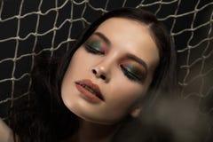 Beautiful make-up woman in Fishing net Stock Photo